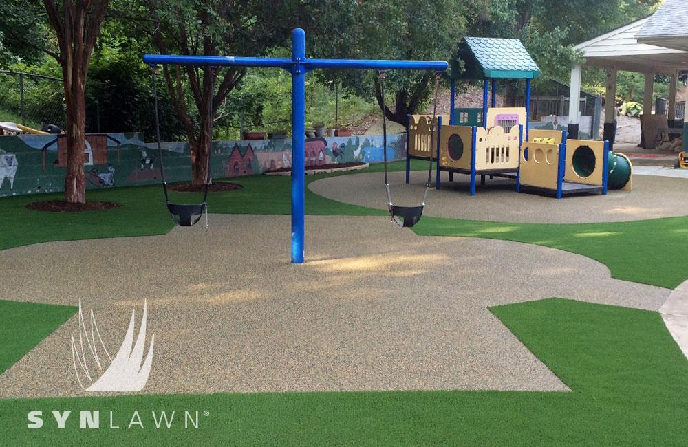 turf installation on community playground