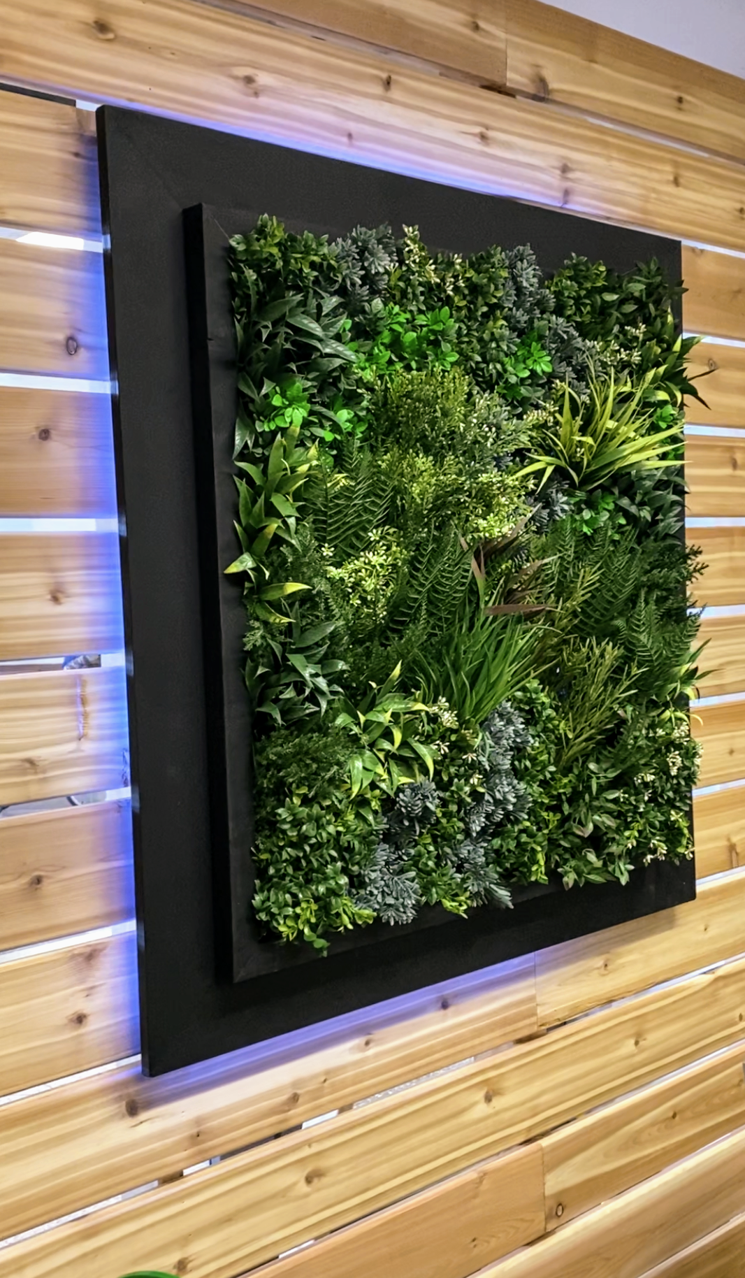 artificial green wall in commercial space